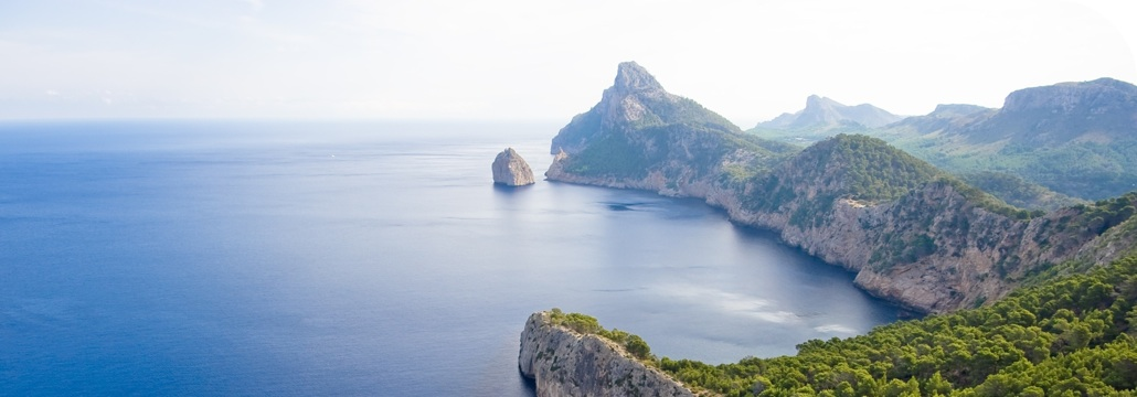 Sail there from Barcelona, it is the closer balearic island